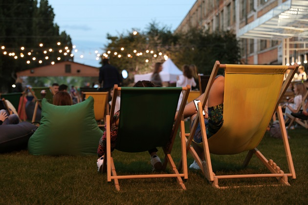Modern open air cinema with comfortable seats in public park